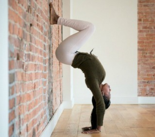 wall the-scout-guide-yoga-with-nya-handstand-pose